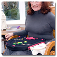Woman in wheelchair using Trabasack Curve Connect wheelchair lap tray and bag
