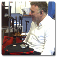 Man in a wheelchair using Trabasack Curve Connect wheelchair lap tray and bag