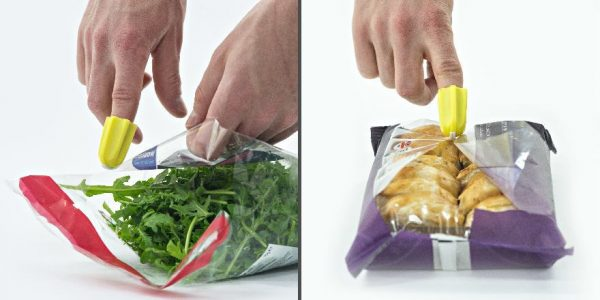 Nimble one-finger cutter being used to open plastic bags
