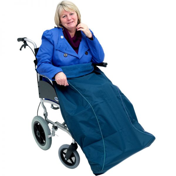 Disabled woman in navy Seenin waterproof wheelchair leg cover