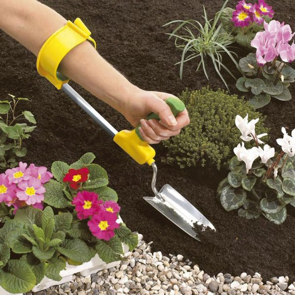 Easi-Grip cuff for garden tools being used in flower bed with garden trowel
