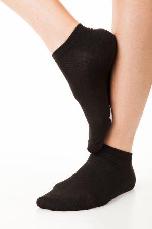 Black socks on white legs